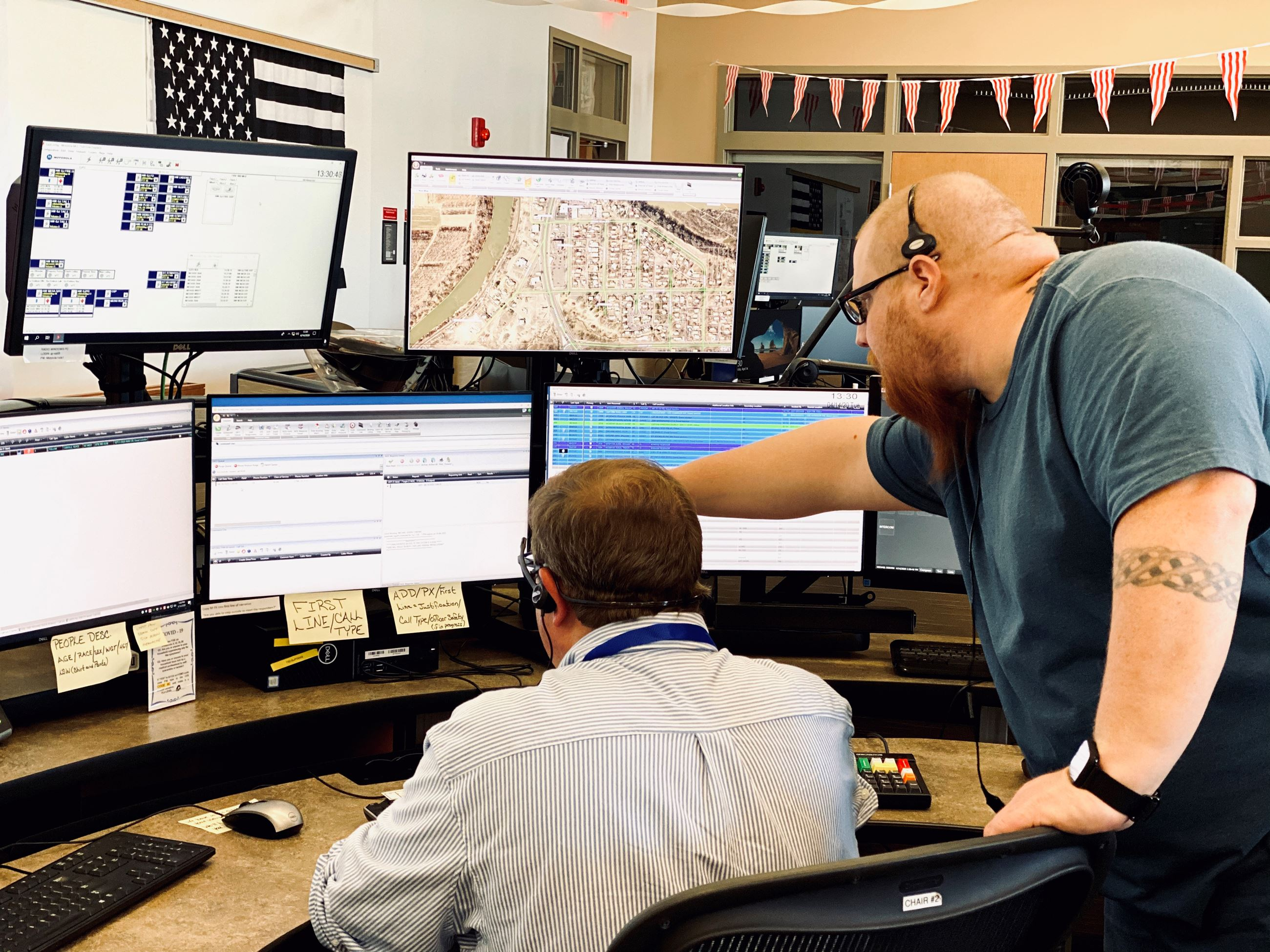 Image of two 911 dispatchers working in the dispatch center